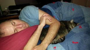 Snuggling with her daddy